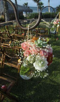 Pink roses, succulents, baby breath, ranunculus in mason jars