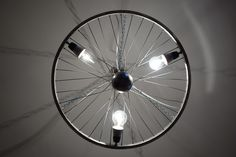 """Giro"" chandelier made from an old bike wheel on the anniversary of Giro d´Italia 2017 Mustang Wheels, Light My Fire, Bike Wheel, Old Bikes, Luster, Anniversary, Chandelier, Ceiling Lights, Homemade"