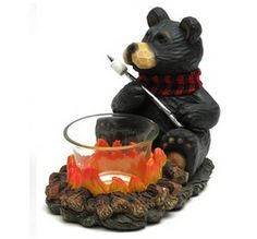 Northwood Bear Votive Candle Holder -Northwood Bear Votive candle holder - Adorable little guys toasting their treats with your candle will bring a smile every time! Measures 3.75 x 4.5 x 5.5 and is made of resin. Candle not included  CHER BEAR DECOR U$10.95