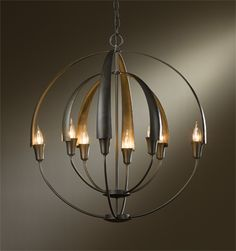 """Cirque; Chandelier with eight lights; large. U.S. Patent D705,475 Chain-hung DIMENSIONS: 27.9"""" h. x 25.4"""" d. MAX. HANGING WEIGHT: 11.4 lbs. SOCKET TYPE: candelabra BULB: (8) B, 60 watt max. Dark Smoke finish (-07)"""