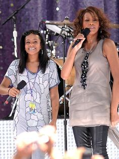 Whitney Houston, right, sings with her daughter Bobbi Kristina Brown during a performance on Good Morning America in Central Park in New York on September 1, 2009.
