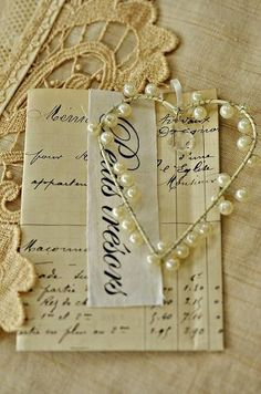 wire and pearl heart - I could try and diy this. (Link to blog homepage, not exact post)