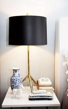 Function meets beauty.  Without the vase and horse sculpture, this lamp would seem too tall for this table.