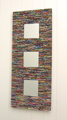This mirror trio wall art will make a statement in your home and its made from recycled magazines! The idea behind this piece started with