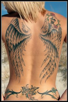 See more Black and white Angel's wing tattoo on back of body ...