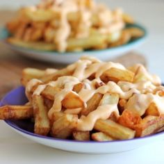 Double-fried french fries topped with the most amazing garlicky cheese sauce. #foodgawker