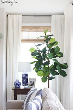 Living room window treatments featuring budget-friendly cordless woven shades and linen cotton curtains, paired with black curtain rods. Living Room Decor Curtains, Living Room Decor Cozy, Living Room Windows, Living Room Modern, My Living Room, Large Window Treatments, Farmhouse Window Treatments, Window Treatments Living Room, Window Coverings
