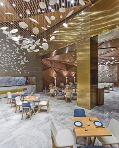 Inspired by traditional landscape paintings, PANORAMA recently completed the Yue Restaurant in a Chengdu boutique hotel that features suspended ceramic sculptures hovering dramatically above the dining area. : Ng Siu Fung. #architecture #interiors #design #interiordesign #restaurant #china... - Interior Design Ideas, Interior Decor and Designs, Home Design Inspiration, Room Design Ideas, Interior Decorating, Furniture And Accessories