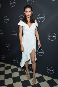 Adriana Lima takes the plunge in dress with slit - September 2017