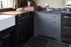 An eclectic union: we combined a variety of worktops to create a truly varied feel, from the blue and cream solid wood cupboards with a mix of granite and wooden worktops, to the more subtle freestanding furniture.
