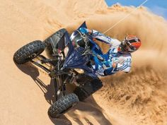 Yamaha's YFZ 450R was designed to win championships but the same nimble handling and excellent suspension that make it a winner on the track work excellent in the sand as well. We love it!  Yamaha brought a truck load of their sport ATVs to Glamis, and I was determined to ride them all.  After a great day on the awesome Raptor 700, I really didn't want to give up the easy riding dune monster, but I thought I should get in some quality time with YFZ 450R as well.