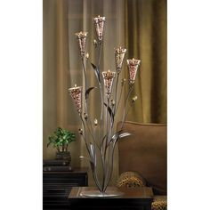 Leopard Lily Blossom Candle Tree, Tall bouquet of six trumpet blossoms in their full leopard spotted glory surrounded by copper leaves and stems. Reaching to over tall, this table top candelabra will light up your surroundings beautifully. Candle Centerpieces, Centerpiece Decorations, Candle Lanterns, Tea Light Candles, Votive Candles, Wedding Centerpieces, Tea Lights, Candleholders, Glass Candle