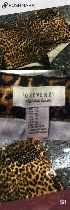Cheetah print Forever 21 shorts Size 24 cheetah print shorts! Zipper detail on both sides and grommets on one pocket! See photos! Forever 21 Shorts Jean Shorts