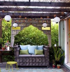 Antique Carved Bed Panel from Indonesia & Indian Bench.  balinese terrace interior design2
