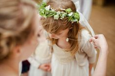 Flower girl wears flower crown with white flowers  | Photography by http://www.christophercurrie.co.uk/