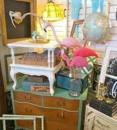 Summery display in my booth @curiositiesvintage  #flamingo #vintagebooth #summer #dresser #globe #pink