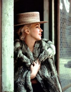 Marilyn monroe . I love the pairing of a fur coat and a straw boater . 1950s fashion