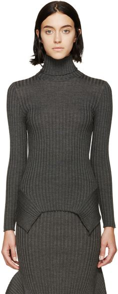 Long-sleeve light wool turtleneck in grey. Ribbed texture throughout. Serged cuffs and hem. Panelled construction at hem. Tonal stitching.