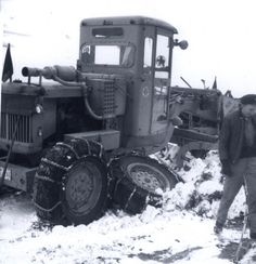 Here's hoping this snowy #ThrowbackThursday photo helps you cool off on this warm day. You're looking at a grader with a broken axle. This shot was taken in 1964. #tbt