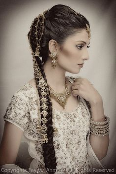 This is a beautiful example of the exquisite jewelry available for braided hair, in the Indian tradition.