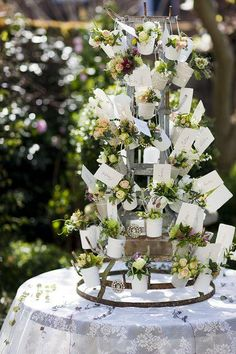 ~~ Hanging flowers by Zita Elze Flowers on French bottle rack, escort cards