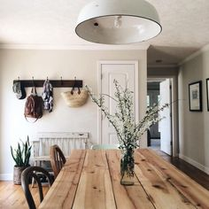 I like the entrance with the sturdy rack and the rustic bench