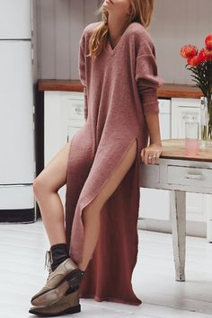 Love the length, color, neckline, and unexpected length with side slit of this sweater dress