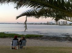 Couple watching the sunset at Punta del Este, Uruguay l Southamerica l @tbproject