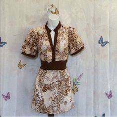 CHARLOTTE RUSSE Blouse with Tie Back Sash Gorgeous blouse with attached sash that ties in the back. Brown/chocolate, light brown, Creme & white hues. Women's size large. Wrinkle free fabric. 100% polyester. Never worn. No tags. All items smoke & pet free Charlotte Russe Tops Blouses