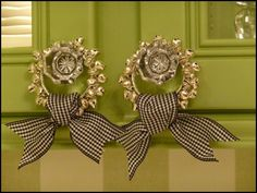 simple ribbon tied onto a jingle bell napkin ring used as a little wreath on kitchen cabinet doors!