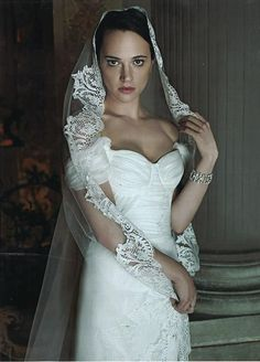 Asia Argento wearing a wedding dress from Alberta Ferretti  Forever 2013 collection on IoDonna magazine