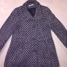 Kenneth Cole Jacket Kenneth Cole Jacket in black and white print. Worn a few times and has 3 buttons going down with side pockets Kenneth Cole Jackets & Coats