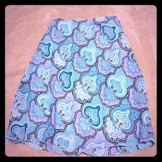 Knee length elastic waist skirt Knee length elastic waist skirt. Amazing colors! The turquoise and purple really stand out sheer top with a light turquoise liner. Elastic waist super comfy. No rips stains or tears from a smoke-free pet free home Skirts