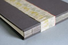 ribbon on cover and through binding
