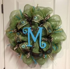 Green Deco Poly Mesh Wreath with Peacock Ribbon and Turquoise Initial or Gold Fleur de Lis' Spring Wreath Summer Wreath Fall Wreath. $63.00, via Etsy.