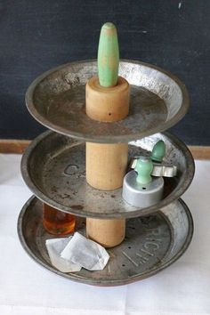 Really neat idea for a tiered kitchen organizer, but I kinda hate the thought of ruining vintage pie pates.