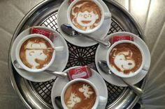 A talented Barista gathered the peanuts gang together for a tasty reunion in these assembled cups.