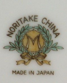 Noritake Back Stamp: What the M Means. The M in the wreath mark was used from around 1914 to 1940. Noritake stopped importing to the United States in 1940. The M stands for Morimura. (The Morimura brothers were early importers of Japanese goods to America.)  After the war, several years went by before Noritake started to supply dinnerware to the US again. As of the 1950s, they had replaced the M with an N for Noritake, and kept the colored wreath motif.