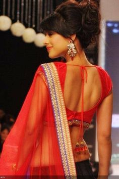 Nia Sharma- Ek Hazaaron Mein Meri Behna Hai actress Nia Sharma is flaunting her curvaceous body and was also sporting a backless red blouse at a fashion show which was held recently. Nia Sharma shot to fame with Star Plus's Ek Hazaaron Mein... and is currently working on her comeback show. Nia Sharma and Kushal Tandon of Bigg Boss fame made a nice pairing in the show and fans would definitely love to see them back as a pair on TV.