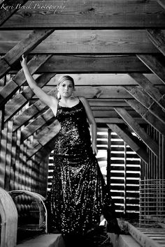 2014 High School Senior girl for posing picture ideas. Old barn and prom dress...vintage look. Modeling in an old barn in her prom dress and cowboy boots. Trash the dress photo shoot session.