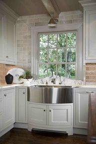 Luscious kitchens - mylusciouslife.com - curved marble backsplash at sink in front of window  Design Galleria