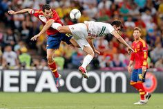 Spain's Alvaro Arbeloa (left) and Portugal's Nelson Oliveira jump for the ball during the Euro 2012 soccer semifinal match between Spain and Portugal in Donetsk, Ukraine
