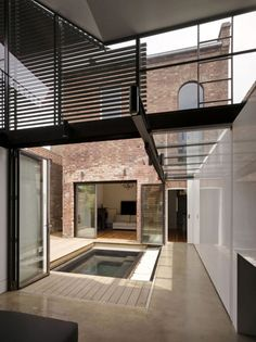 Love the use of courtyards to open a house up. Could see our office on one side and the house on the other with a pool in the middle.