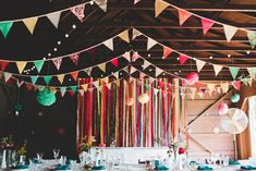 Colorful bunting and streamers at the reception - under the trellis that will hold the lecturn for main speech.