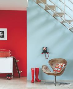 Add a little drama with one red accent wall.