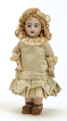 """Premier Bleuette Bebe France, ca.1910, poured bisque socket head, raised 2 on head, blue paperweight eyes, finely painted brows and lashes, open mouth with four teeth, pierced ears, blonde mohair wig with cork pate, fully jointed composition body with incised 2 on foot (faint), wearing vintage French dress, antique brown leather shoes Size: 11"""" t. 28cm tall"""
