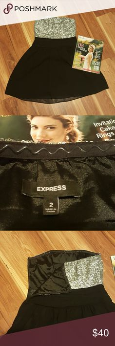 EXPRESS Strapless DRESS!! Beautiful mini strapless dress from Express. Zipper opening from left side. Polyester Lining. Used but hardly worn!! Express Dresses Mini