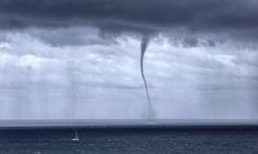 01/08/2016 - Incredible photos show the terrifying moment a yacht is forced to flee for safety after a giant 1,000ft waterspout rises up from the sea - a tornado above the ocean kicked-off a four-day storm in Sydney, AU just off the coast of a popular beach.