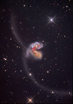 The Antennae Some 60 million light-years away in the southerly constellation Corvus, two large galaxies collided. But the stars in the two galaxies cataloged as NGC 4038 and NGC 4039 don't collide in the course of the ponderous, billion year or so...