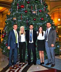 The 2013-2014 Illinois Senate GOP interns in the front of the Capitol Christmas tree: (left to right) Tyler, Tina, Noah, Jenna & Brett